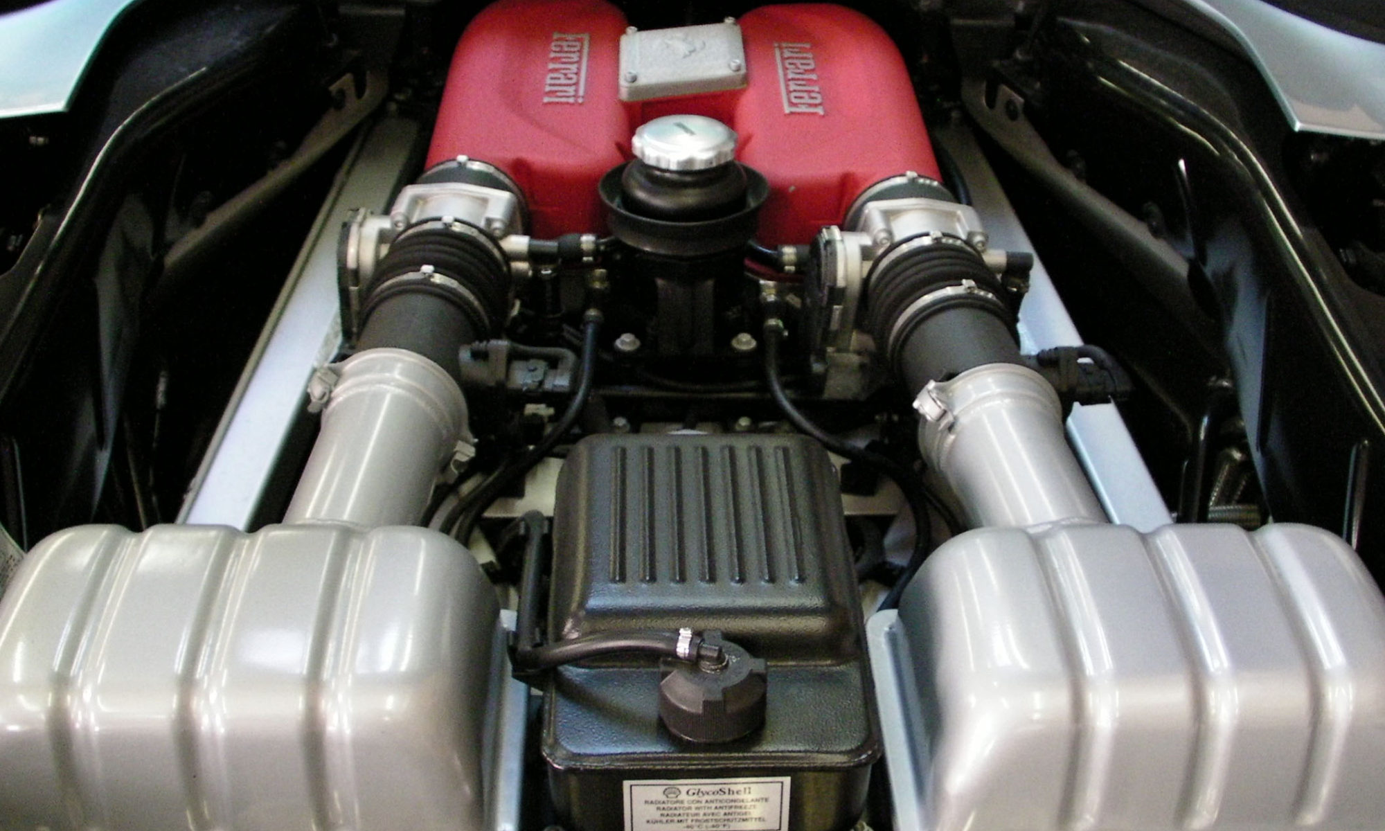 Ferrari F360. Services: Color coated air intake with K&N filter upgrade.